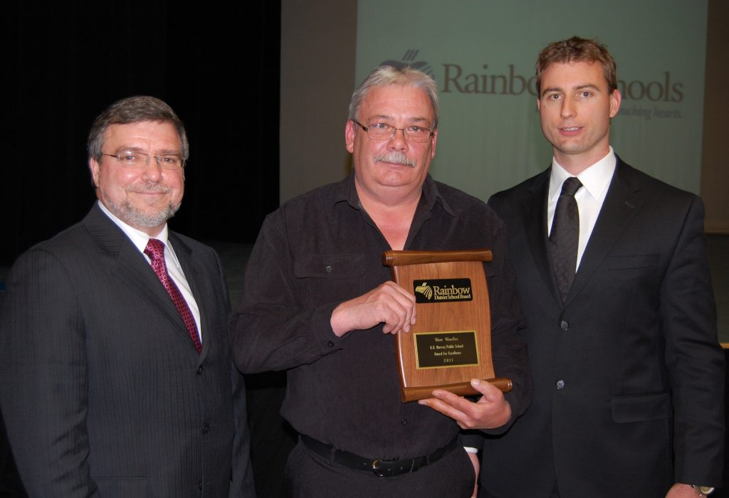 A staff member accepting an award