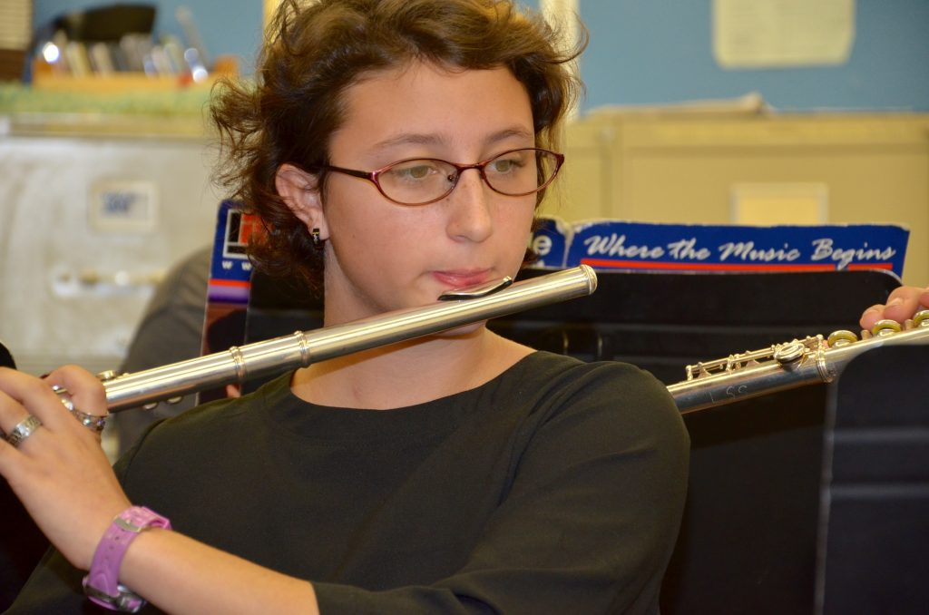 An image of a student playing the flute.