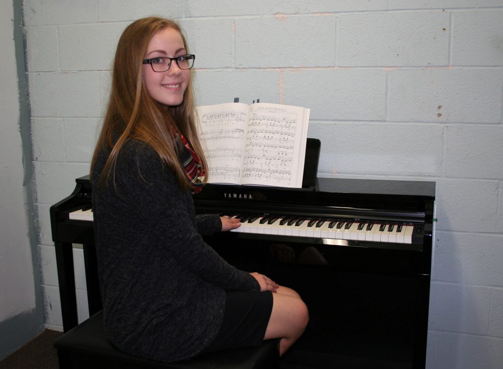 An image of a student playing piano
