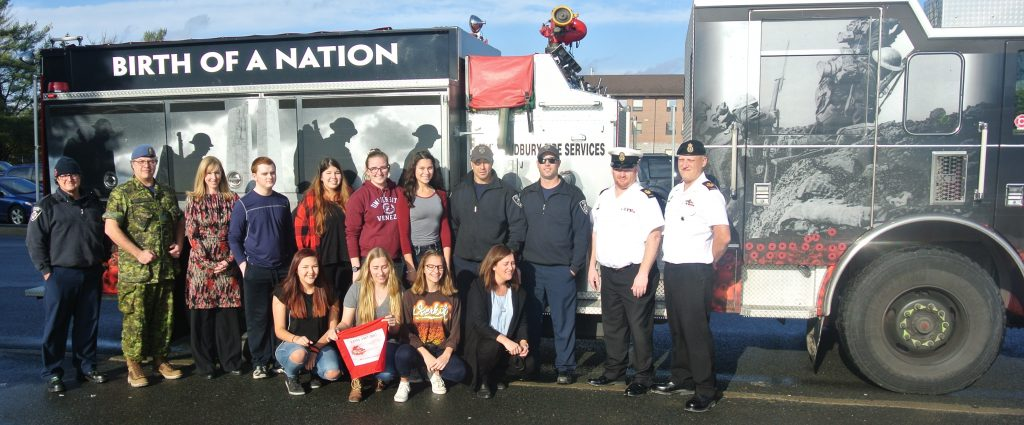Images of students, fire fighters and canadian armed forces with the Vimy Commemorative Fire Truck