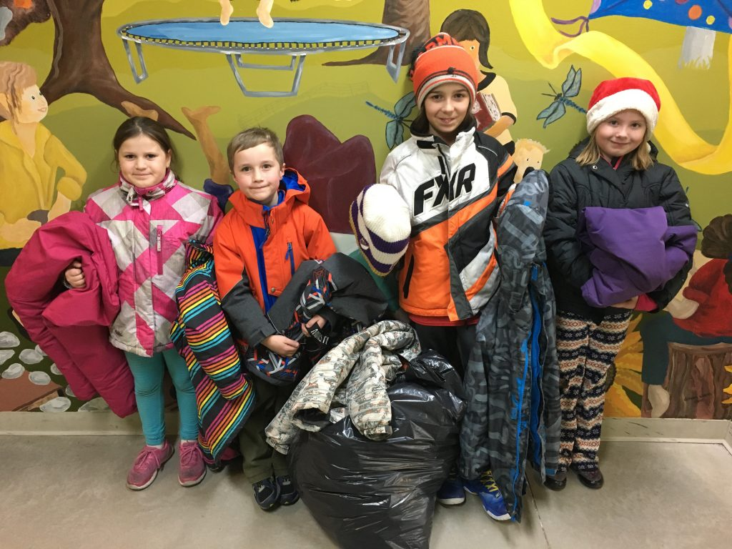 Students standing with winter clothing