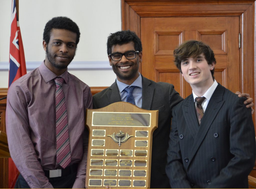 An image of students with an award