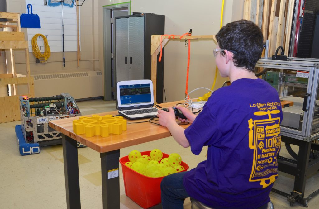 A student working on the FIRST Robotics