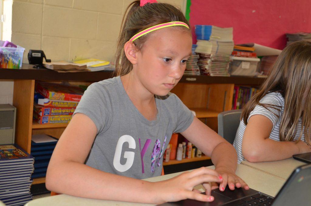 Maeve Leduc, a Grade 5 student from R.L. Beattie Public School, uses a Chromebook.