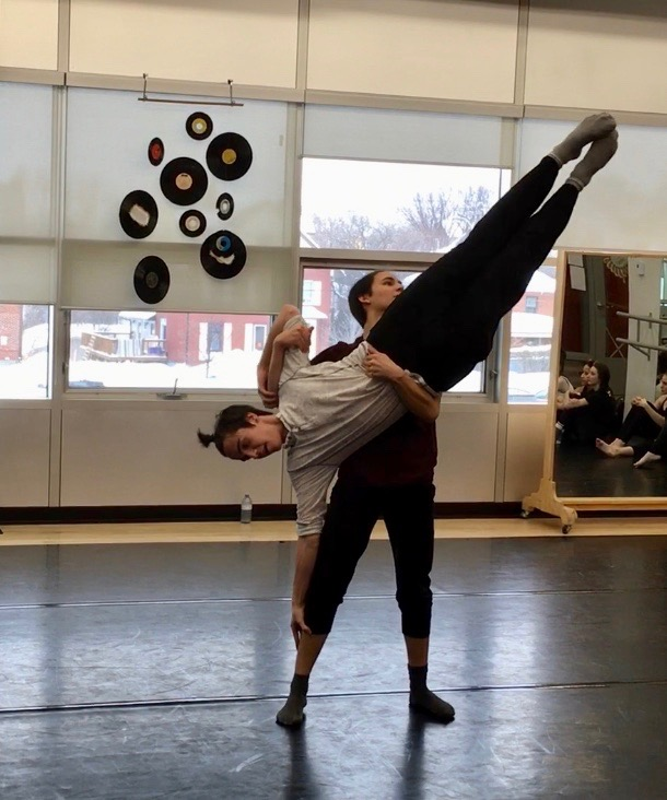 students practicing an elevated partner dance technique