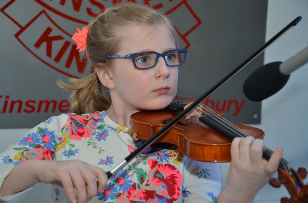 a photo of a student playing the violin